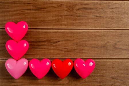 Small heart : red and pink ball with shape heart for valentines card on wooden background with copy space.