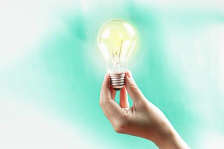 Hand hold a lightbulb,Innovation or  creative concept.