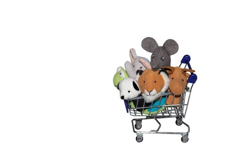 animal dolls in shopping cart with isolated white background 写真素材