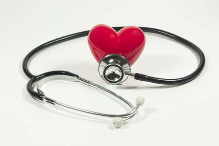 Red heart and a stethoscope on isolated white background. Imagens