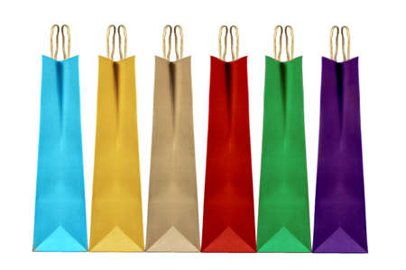 Colorful paper shopping bags isolated on white, clipping path included.