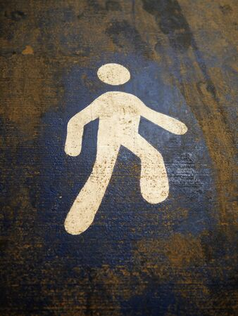 Walking sign on the ground