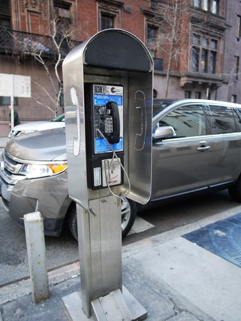 phone button: New York City - April 2 2017. Street phone booth, an almost antiquated technology in NYC Editorial