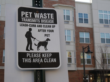 sign saying you must clean up after your dog