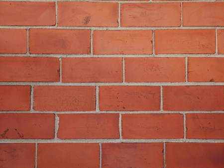 Brown orange brick wall staggered stacked Stock Photo