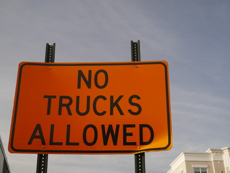 Orange No Trucks Allowed sign