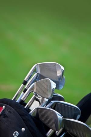 Golf sticks on grass golf sticks vertical composition photo