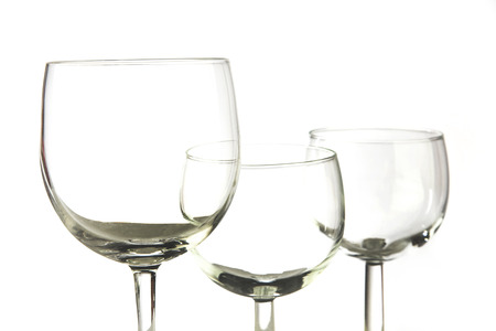 closeup photo of three empty glasses on white background photo