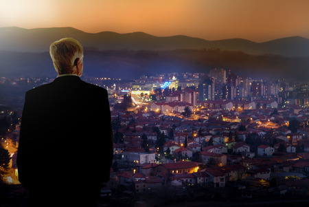 campaign promises: political candidate watching his  city