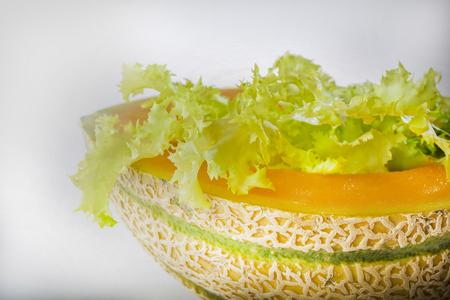 lettuce in melon symbolizing vegeterian food