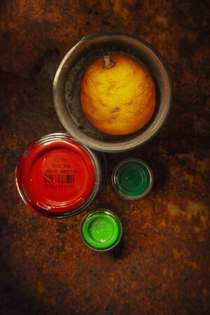 four colour cans with orange red and green colors Reklamní fotografie - 137072455