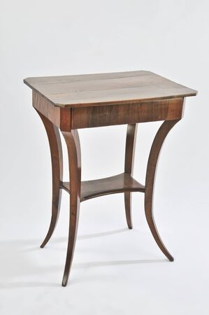 antique beautifully elaborated small table on white background