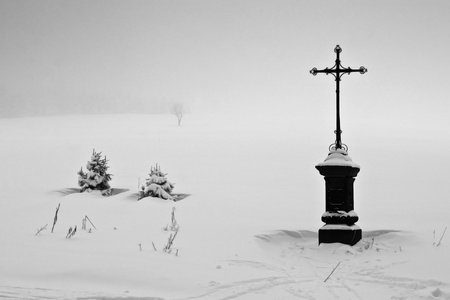 Holy Cross in Snowy Landscape  Black and White   Stock Photo - 15982796