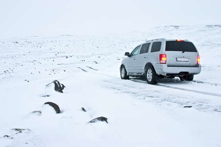 Offroad Car on the Snowy Road in Blizzard Stock Photo