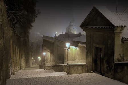 Prague Castle Stairway Leading to The Old Town of Prague in Winter Night, Czech Republic photo
