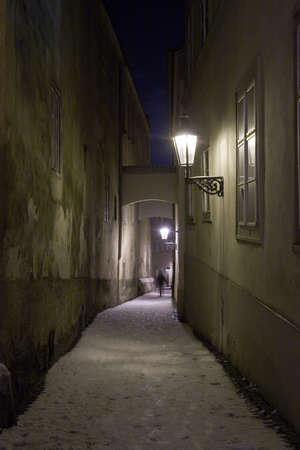Shadow Silhouette at the End of Old Narrow Street  In the Winter and Night, Prague, Czech Republic Stock Photo