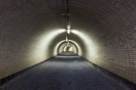 Perspective View Through a Dark Tunnel Floodlighted by Tubes