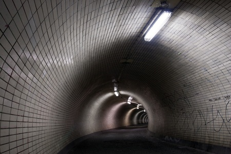 Perspective View Through a Dark Tunnel Floodlighted by Tubes Stock Photo - 17420872