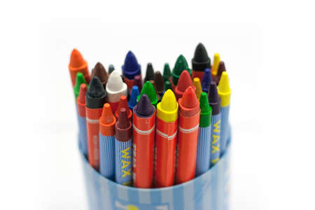 Many Colorful Wax Crayons in The Cup on The White Background photo