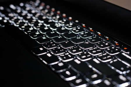 White Backlit Keyboard in Darkness Stock Photo