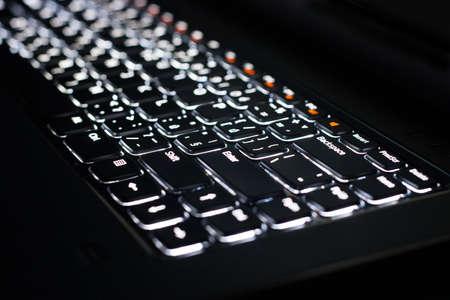 backlit keyboard: White Backlit Keyboard in Darkness Stock Photo