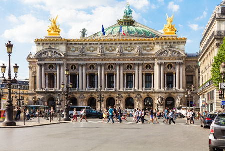 garnier: Paris, France - August 21, 2015: Front view of the Opera National de Paris. Grand Opera (Opera Garnier) is famous neo-baroque building in Paris. Designed by Charles Garnier in 1875. Editorial