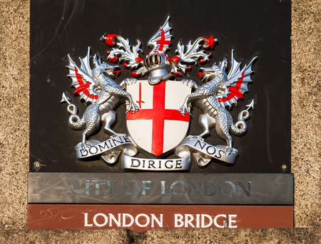 architectural styles: Royal heraldic sign on London Bridge in the summer evening at sunset. Stock Photo