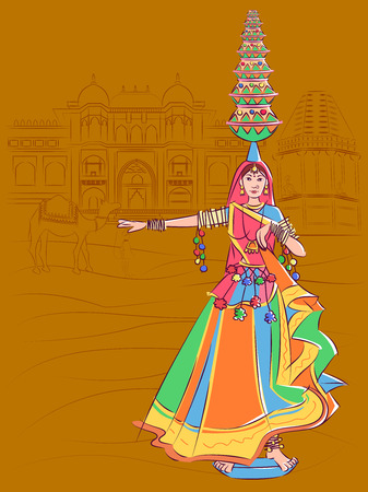 Woman performing Matki folk dance of Madhya Pradesh, India
