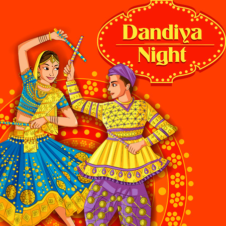 Indian Couple playing Garba in Dandiya Night Navratri Dussehra festival
