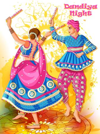 Indian Couple playing Garba in Dandiya Night Navratri Dussehra festival
