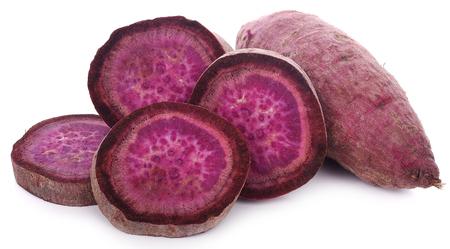 Purple Colored Sweet Potatoes on White background Фото со стока