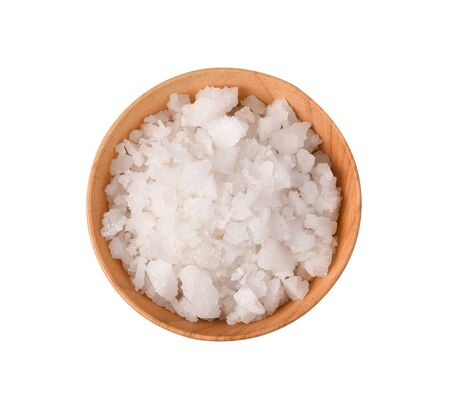 Top view salt in a wooden bowl isolated on white background
