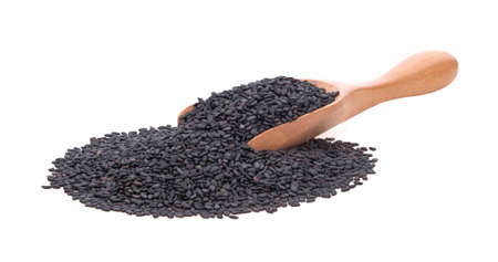 Black Sesame seeds in wooden scoop isolated on white background