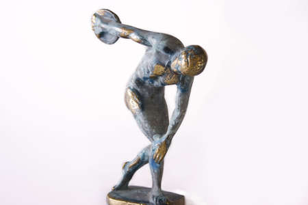 Metalic statue of greek discobolus photo