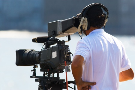 Tv operator with camera reporting Stock Photo