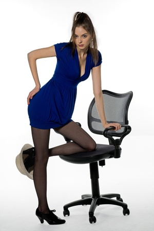 Aggressive girl with straw hat  on leg in office Stock Photo - 9198464