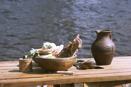 Table with vikings dishes and food Stock Photo