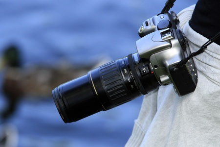 photocamera: Photocamera on strap at side of master