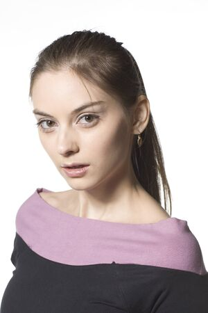 glance: Young female looking in camera with iquiring glance Stock Photo