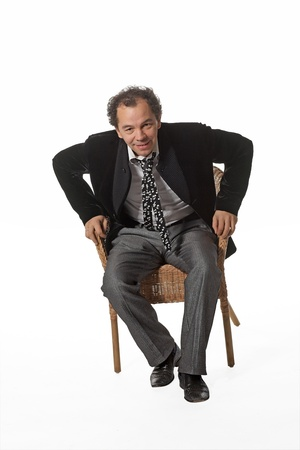 Mature man standing from chair toward  you