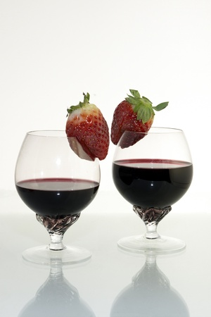 Two goblets with coctail and berries