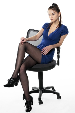 stockings feet: Beauty on chair in imposing pose Stock Photo
