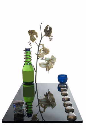 implication: Sake bottle,lilies,cup and stones - still life