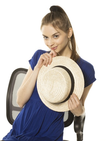 Smiling girl with hat in hand Stock Photo