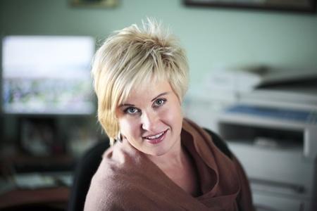 looking ahead: Smiling blonde looking ahead in office