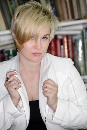 looking ahead: Blonde looking ahead on books background