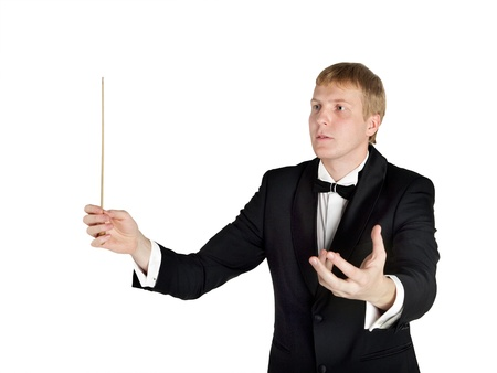 conducts: Conductor conducts with baton in hand
