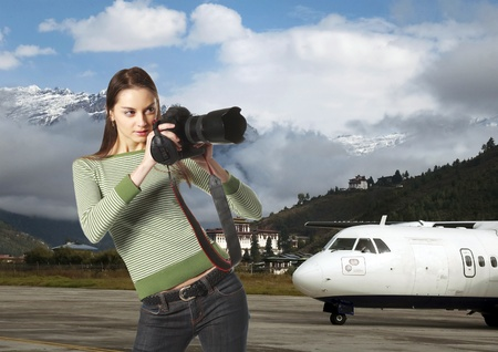 landing strip: Attractive girl-photographer on landing strip Stock Photo