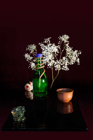 Still life with bottle and cap photo