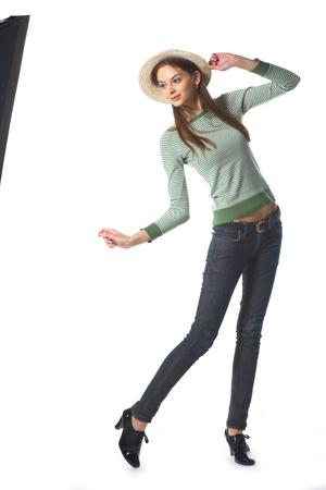 whirling: Girl in bonnet posing before light box in studio